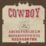 Alfabeto retro en el estilo occidental, estilo del vaquero, fuente de vector para las etiquetas Fotografía de archivo libre de regalías