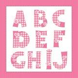 Alfabeto rosado de la tela. Imagenes de archivo