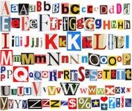 Alfabeto variopinto del giornale Immagini Stock