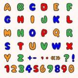 Alfabeto variopinto e numeri Fotografie Stock