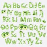 Alfabeto verde de la historieta con los ojos Imagen de archivo libre de regalías