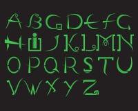 Alfabeto verde en un fondo negro en estilos modernos Foto de archivo