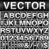 Alfabeto y números del odómetro Imágenes de archivo libres de regalías