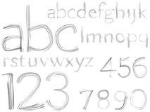 Alfabeto y números drenados mano del bosquejo Fotos de archivo