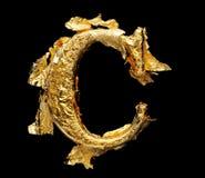 Alfabeto y números en hoja de oro áspera foto de archivo libre de regalías