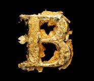 Alfabeto y números en hoja de oro áspera fotos de archivo