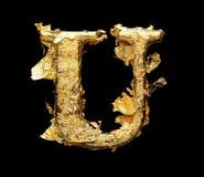 Alfabeto y números en hoja de oro áspera foto de archivo