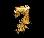 Alfabeto y números en hoja de oro áspera imagenes de archivo