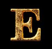 Alfabeto y números en hoja de oro Foto de archivo libre de regalías
