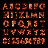 Alfabeto y números llameantes Foto de archivo