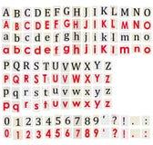 Alfabeto y números anónimos en el fondo blanco. Fotografía de archivo