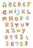 Alfabeto y números rayados Foto de archivo libre de regalías