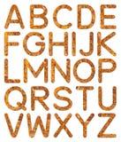 Alfabeto A a Z de la textura de la pared de piedra de la fuente Foto de archivo