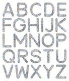 Alfabeto A - Z di struttura della parete di pietra della fonte Fotografia Stock