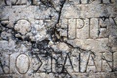 Alfabetos antigos no fundo de mármore fotografia de stock