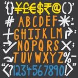 Alfabetos coloridos, números y caracteres especiales Fotografía de archivo libre de regalías