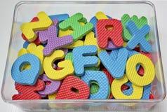 Alfabetos de goma en caja Imagen de archivo