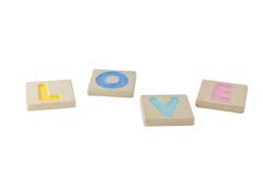 Alfabetos de madeira isolados no fundo branco Fotografia de Stock