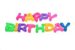 Alfabetos del feliz cumpleaños en el fondo blanco Foto de archivo
