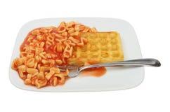 Alfabetspaghetti en wffle Stock Foto