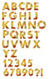 Alfabetuppsättning som planläggs i höstfärgmosaik Arkivbild