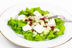 Alface, aipo, feta, sementes da romã em um branco Imagem de Stock Royalty Free