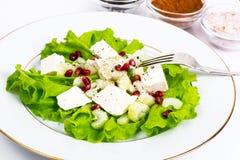 Alface, aipo, feta, sementes da romã em um branco Fotos de Stock Royalty Free