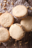 Alfajores cookies on paper close-up on the table. Vertical top v Stock Image