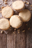 Alfajores cookies on paper on the table. Vertical top view Royalty Free Stock Photo