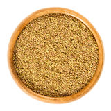 Alfalfa seeds in wooden bowl over white. Alfalfa seeds in wooden bowl. Lucerne, Medicago sativa. Used for sprouting and germinating with water in a jar for royalty free stock photo