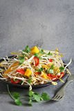 Alfalfa sprouts salad with mango,red chilli,toasted almonds and coriander Royalty Free Stock Photos