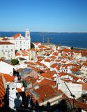 Alfama Lisbon. Aerial view of Alfama district of Lisbon with ocean in background, Portugal royalty free stock photography