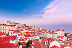 Alfama at scenic sunset, Lisbon, Portugal. View of Alfama, the oldest district of the Old Town, with Monastery of Sao Vicente de Fora, Church of Saint Stephen Royalty Free Stock Photography