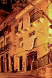 Alfama street at night in Lisbon, Royalty Free Stock Photos
