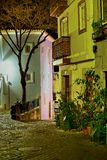 Alfama street at night in Lisbon, Royalty Free Stock Images