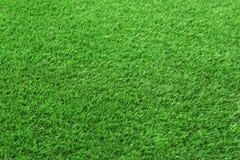 Alfombra artificial de la hierba como fondo, primer fotografía de archivo libre de regalías