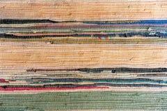 Alfombra hecha a mano multicolora de la tela fotografía de archivo