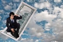 Alfombra mágica del dólar Imagen de archivo