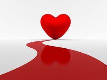 Alfombra roja al corazón Imagenes de archivo