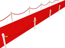 Alfombra roja con las barreras de la cuerda en el fondo blanco Foto de archivo