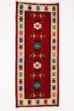 Alfombra tradicional de la artesanía con adornos étnicos Fotos de archivo