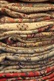Alfombras persas de la pila alta Foto de archivo