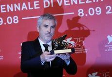 Alfonso Cuaron pozy z Złotym lwem fotografia stock