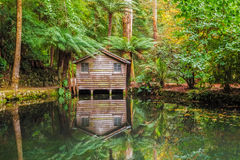 Alfred Nicholas memorial gardens lake in autumn with boat shed. Royalty Free Stock Photos