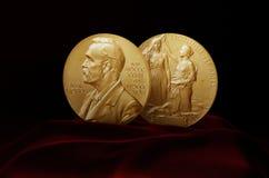 Alfred Nobel Prize. Nobel Prize Medal standing on a platform. Red and black background. Made in 3D softwaren stock images