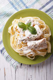 Alfredo pasta in cream sauce with chicken closeup. vertical top Royalty Free Stock Photo