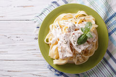 Alfredo pasta in cream sauce with chicken. horizontal  top view Royalty Free Stock Images