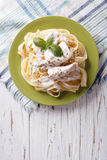 Alfredo pasta in cream sauce with chicken. vertical top view Royalty Free Stock Photography