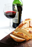Alfresco. Fresh sourdough bread, with bottle and glass of red wine royalty free stock photography