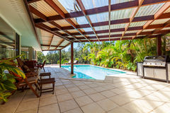 Alfresco backyard. With swimming pool Stock Photography